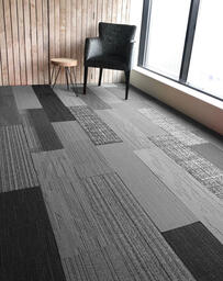 Looking for Interface carpet tiles? AAA Shuffle It Skinny Planks in the color Shades of Grey is an excellent choice. View this and other carpet tiles in our webshop.